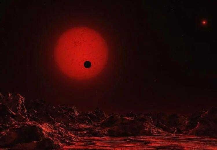 Вид с поверхности расположенной у красного карлика планеты в представлении художника