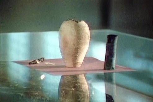 сосуд, запечатанный битумом